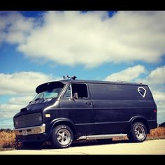 Here's a cool Dodge boogie van! Like the bubble window, side pipes, fender flares, & Cragars.