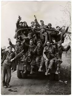 Recently liberated American POWs wave as they leave their camp.Tangermunde, Germany. 1945.
