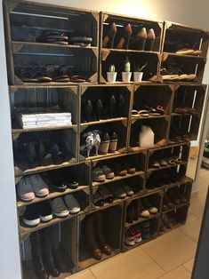 Homemade shoe rack with old fruit crates.