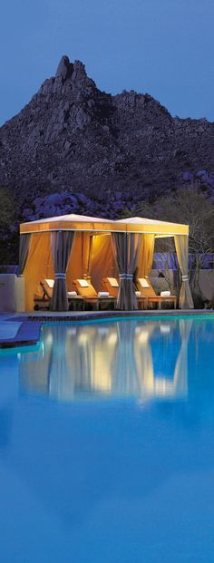 Poolside cabanas and a moonlit desert make for the ultimate serene scene @Mandy Dewey Seasons Resort Scottsdale at Troon North.