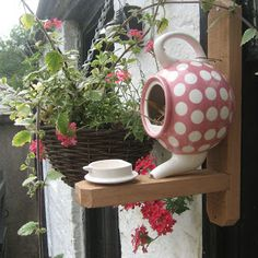 A teapot birdhouse.  This website has so many ideas.  You need to check it out