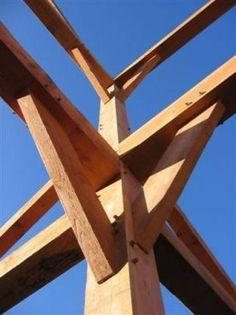 Traditional oak framing methods using oak pegs. Roderick James Architects.