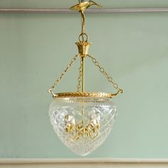 A cut glass and brass pendant light, 500 ea