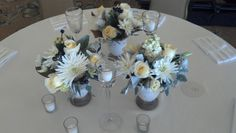 A trio of flowers in ceramic vases, a trio of tall votives and lots of small votives - by Julie for Michael's Flower Girl