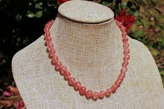 "This 6mm Round Cherry Quartz Gemstone Beaded Necklace is 12"" long. This necklace is hand knotted next to each bead, to ensure safety for small children in case the necklace were to break. The Hook Cla"