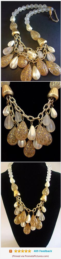 Frosted Lucite Tear Drop Bib Necklace, Carved Ribbed Beads, Magnetic Closure...Vintage https://www.etsy.com/renaissancefair/listing/508634916/frosted-lucite-tear-drop-bib-necklace?ref=shop_home_active_1  (Pinned using https://PromotePictures.com)