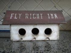 Fly Right Inn 3 Hole primitive Birdhouse. $ 30-- craftsbymerle via Etsy.