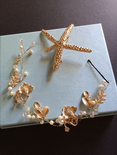 A personal favourite from my Etsy shop https://www.etsy.com/hk-en/listing/260090577/gold-starfish-leaf-and-pearls-romantic