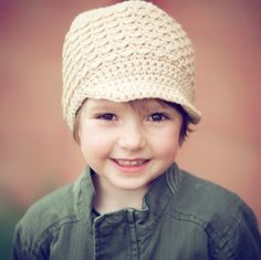 Need to find a pattern? Saw this on a blog. It is for sale on Etsy somewhere . . . blogger says Newsboy (or Girl) Hat   A crocheted urban beanie style hat to keep your kiddo warm and stylish in the cool weather.   From My Hobby Shop on Etsy - $20