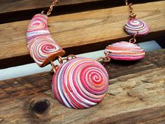Polymer clay necklace by Dev'Art60, made using an extruder.