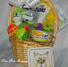 It's the Cat's Meow! This pretty willow gift basket, filled with delectable feasts, furry friends,  tiny mice, balls to chase, a pretty photo frame and a cat themed coaster.  Our Cat's Meow Gift Basket is the purrr-fect gift for even the most finicky feline. Paws down, our It's the Cat's Meow Gift Basket is a sure hit for the cat or cat lover in your life. pawpalsboutique.com