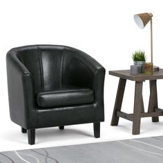 The perfectly transitional Brooklyn + Max Hudson Faux Leather Barrel Chair works beautifully in classic and contemporary homes. This handsome tub chair. Round Swivel Chair, Barrel Chair, Solid Wood Furniture, Furniture Companies, Engineered Wood, Tub Chair, Chair Design, Accent Chairs, Living Spaces