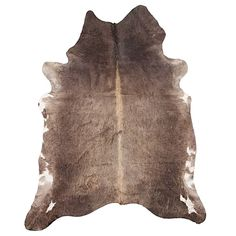 Travel to the outback in your living room with the rustic look and natural soft feel of the Natural Cowhide Rug, Mocha from NSW Leather Co, a genuine rug of high end quality.