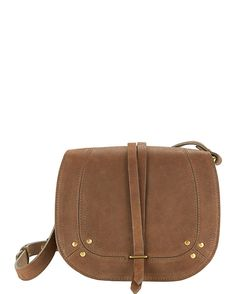 Jerome Dreyfuss Victor Crossbody: Gold-tone ring detail trim. Flap top with magnetic snap closure. Adjustable shoulder strap. Internal zip pocket. Interior flashlight fob. Measures: 8.25 x 6.5 . Cotton lined. In brown. ...