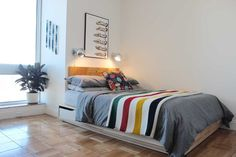 Love the bed! Great idea for extra storage!