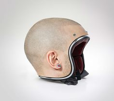 "Motorcycle helmet  - photo from webecoist;  ""Created by Dubai-based digital designer Jyo John Mullor, the trompe-l'oeil helmets are custom-made to blend seamlessly with the user's head so that from afar, it looks like they're not wearing anything at all."""
