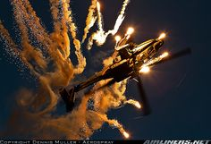 Boeing AH-64D Apache Longbow - Impressive show of the Royal Netherlands Air Force demo team during Sanicole Sunset Airshow.