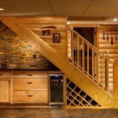 Practical Minibar under Stairs. Love the wine rack and interesting backsplash.