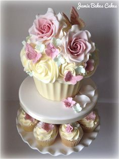 beautiful giant cupcakes | Giant Cupcake cutting cake with sugar roses and butterflies. To serve ...