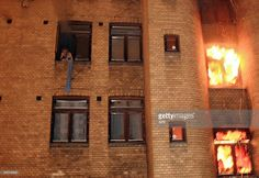 A man shouts for help at a window during a fire in an apartment house in downtown Oslo on December 13, 2008. Six people were killed in a fire in an Oslo apartment building, while one person was seriously hurt and 11 suffered lighter injuries, Oslo firefighters said. Firefighters described the scene when they arrived as 'chaotic'. 'When firefighters got there, people were sitting on the windowsills ... We took down 15 people using ladders,' the fire department said, adding that rescue workers…
