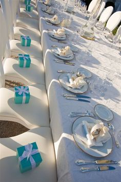 Tiffany blue guest favors add a touch of color to an all white theme... Wedding by Monte-Carlo Weddings.