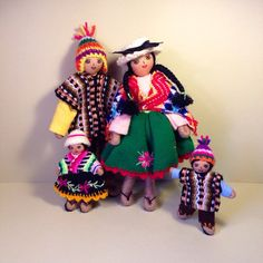 Traditional Peruvian Doll Family  This family of four handmade dolls are dressed in traditional South American clothing. There are two adults and