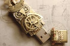 Steampunk Owl USB Flash drive by cybercrafts I like how they assembled the owl out of gears and parts