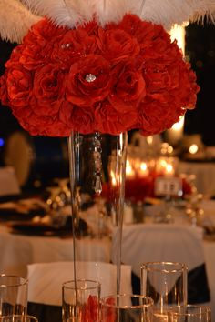 Gala Decor by APaintedFrame.com red rose feather wedding centerpiece