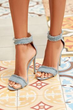 """Street and dressy style combine to bring you the Freya Blue Denim Ankle Strap Heels! Frayed light blue denim covers a wide toe strap, and matching ankle strap with 3.25"""" heel zipper."""