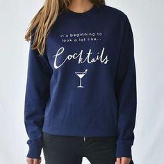 'Looks Like Cocktails' Christmas Jumper Sweatshirt. Shop Christmas Jumpers now.