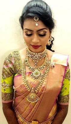 Vidya for reception. Makeup and hairstyle by Swank Studio. Red lips. Glitter eye makeup. South Indian bride. Bridal jewelry. Bridal hair. Silk sari. Bridal Saree Blouse Design. Indian Bridal Makeup. Indian Bride. Gold Jewellery. Statement Blouse. Tamil bride. Telugu bride. Kannada bride. Hindu bride. Malayalee bride. Find us at https://www.facebook.com/SwankStudioBangalore