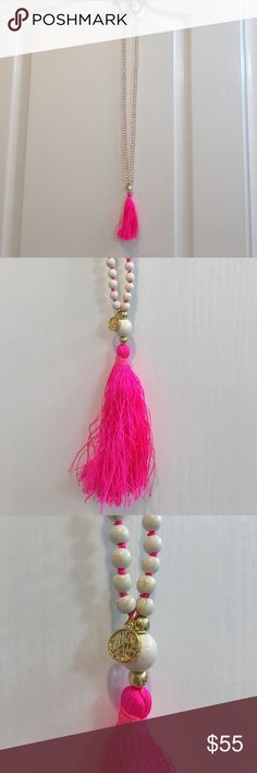 NWT Lilly Pulitzer Necklace. Brand new. Never worn. Pink tassel is 4 inches long. Beads are a cream color with brown lines. Looks like a marble effect. Pink string in between beads. Lilly Pulitzer Jewelry Necklaces