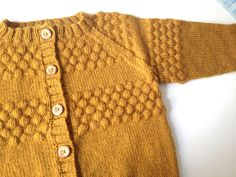♥ the color and stitch pattern of this child's vest