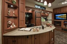 Love this kitchen! Toy Hauler Fifth Wheel RV by Heartland!