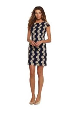 This is a sophisticated and fun dress! I love th  lace with the floral detailing. It can be worn out or even at the office. It all depends on the shoes and accessories you pair with it