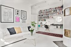 White living room with workspace