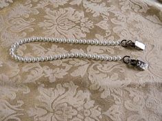Napkin clip  Bib Alternative  Dental Bib clip  White glass pearls.  Put around your neck, clip onto a napkin to hold it in place.  NC490W by NammersCrafts on Etsy
