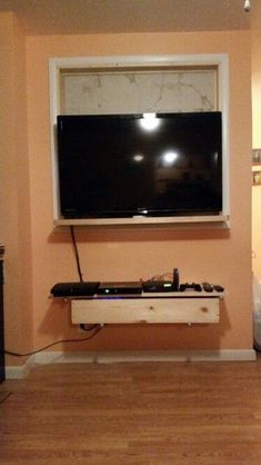 Home Made Tv Wall Mount Insert With Control Shelf And Cord Hide Away Bin.  Also