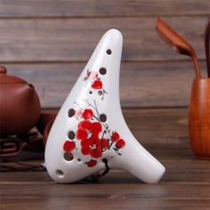 Exquisite 12 Holes Ceramic Ocarina Flute Pottery Instrument Hand Painted Style Sound-Of-Mountain http://www.amazon.com/dp/B00C3W5B4I/ref=cm_sw_r_pi_dp_IwuPub0PVFFJS