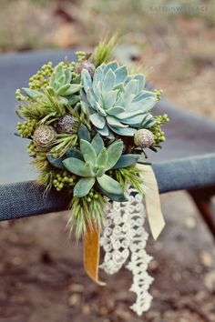 Succulent wedding bouquet...if i ever get married this is what'll be!
