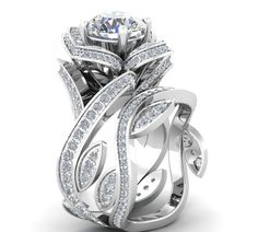 **The Knot has listed the TOP 10 Bridal Set for 2015-16. #1 is the FLORAL DESIGN just like this!** Engagement and Wedding rings are blooming right now with flowers, petals, vines and other details plu