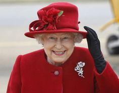 A true red hat and coat. Her brooch stands out so nicely on that red background. The Queen.
