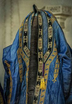 Uzbek old traditional cape dress with face veil, Central Asia. Ethnic textiles.