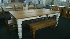 """7ft x 4ft rustic waxed plank-top table on 5"""" turned legs painted in 'House White' & distressed with added side drawer finished with black iron cup-pull handles."""