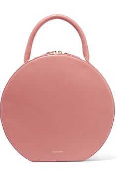 Mansur Gavriel's 'Circle' tote is designed in a clean, rounded silhouette reminiscent of classic hat bags. It's made from the brand's incredibly supple Italian leather and has a smooth suede lining. Store your cell phone and cards in the internal patch pockets.