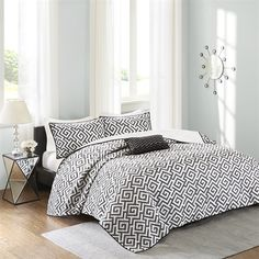 The Madison Park Pure Dimitra Collection creates an organic look for your modern space. The bold black greek key design is the perfect balance to the white background. One embroidered decorative pillow uses top of bed colors mixed with grey to provide drama to this top of bed. Printed on 200 thread count cotton, this set includes one coverlet, two shams and one decorative pillow.