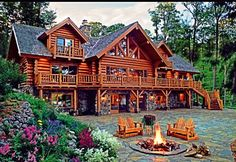 How beautiful this home is. I love the fire pit in the front and the stone work! <3 It would be perfect for Southern Alaska.