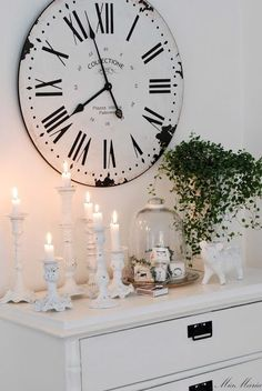 Big vintage clock over white dresser with white candles.  Love the look. I Have the shabby chic candles in the barn.