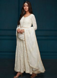 White Thread Embroidered Georgette Anarkali features a georgette kameez with santoon inner, santoon bottom and embroidered georgette dupatta. Embroidery work is completed with thread, sequins and stone embellishments on this style. Designer Anarkali Dresses, Designer Party Wear Dresses, Indian Designer Outfits, Indian Outfits, Indian Clothes, Indian Bridesmaids, Bridesmaid Outfit, Lehenga Designs, Salwar Designs