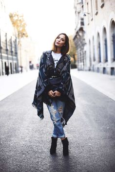 """justthedesign: """"Sofya Benzakour wears a gorgeous traditional style poncho over ripped denim jeans and with a pair of wedge heeled boots. Poncho: Fashion Pills, Jeans: Mango, Boots: Primark, Tee:..."""